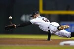 Arizona Diamondbacks first baseman Christian Walker dives in vain for a single hit by Pittsburgh Pirates' Adam Frazier during the first inning of a baseball game Tuesday, July 20, 2021, in Phoenix. (AP Photo/Ross D. Franklin)