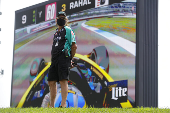 Mark Kellett, father of race driver Dalton Kellett, of Canada, watches the race in front of a video screen during the IndyCar auto race at Indianapolis Motor Speedway in Indianapolis, Saturday, July 4, 2020. The race was run without fans due to the coronavirus pandemic. (AP Photo/Darron Cummings)
