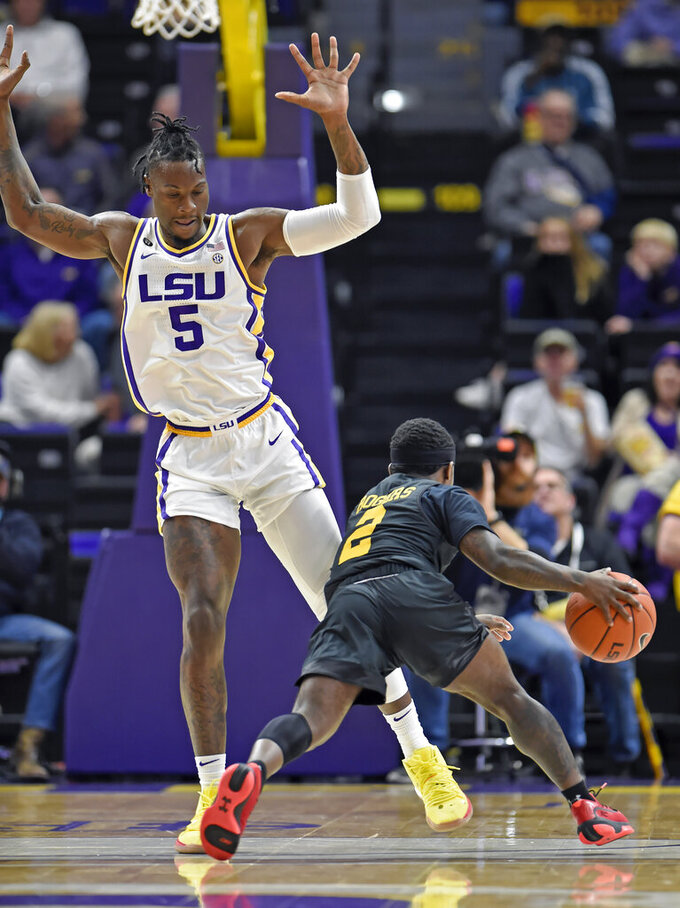 Maryland-Baltimore County guard Darnell Rogers (2) drives around LSU forward Emmitt Williams (5) during the first half of an NCAA college basketball game Tuesday, Nov. 19, 2019, in Baton Rouge, La. LSU won 77-50. (AP Photo/Bill Feig)