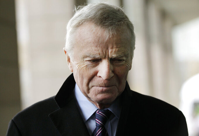 FILE - In this file photo dated Monday, Dec. 5, 2011, former Formula One chief Max Mosley arrives at a Select Committee hearing on privacy and injunctions, in London.  Former Formula One boss and privacy campaigner Max Mosley has died on Sunday May 23, aged 81, it is announced Monday May 24, 2021. (AP Photo/Sang Tan, FILE)