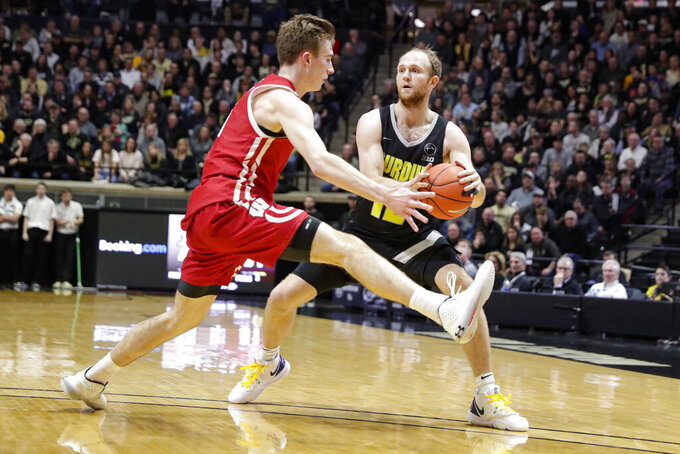 Wisconsin forward Tyler Wahl (5) defends against Purdue forward Evan Boudreaux (12) during the second half of an NCAA college basketball game in West Lafayette, Ind., Friday, Jan. 24, 2020. (AP Photo/Michael Conroy)