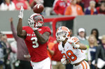 File-This Nov. 4, 2017, file photo shows North Carolina State's Kelvin Harmon (3) catching a touchdown pass as Clemson's Amir Trapp (38) looks on during the first half of an NCAA college football game in Raleigh, N.C. Harmon is coming off a year in which he became the program's first 1,000-yard receiver since 2003.  (AP Photo/Gerry Broome, File)
