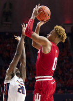 Indiana guard Romeo Langford (0) shoots over Illinois guard Da'Monte Williams during the second half of an NCAA college basketball game in Champaign, Ill., Thursday, March 7, 2019. (AP Photo/Stephen Haas)