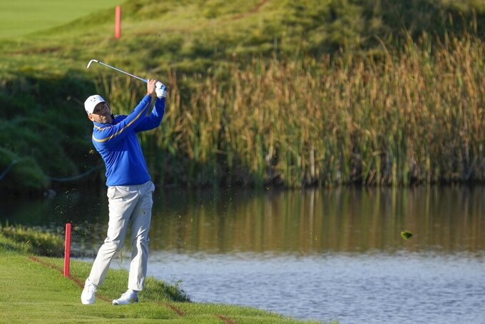 Team Europe's Sergio Garcia hits on the fifth hole during a foursome match the Ryder Cup at the Whistling Straits Golf Course Friday, Sept. 24, 2021, in Sheboygan, Wis. (AP Photo/Ashley Landis)