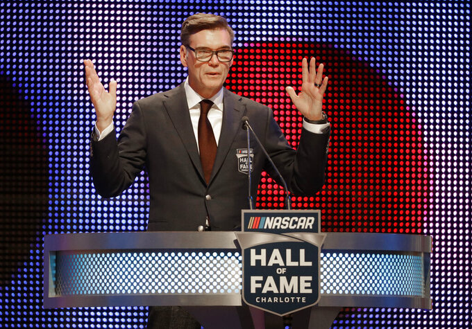 FILE - In this Jan. 19, 2018, file photo, Ray Evernham speaks after being inducted into the NASCAR Hall of Fame in Charlotte, N.C. The IROC Series, where the best drivers from various disciplines raced each other in equally prepared cars, ran for 30 seasons before Tony Stewart won its final championship in 2006 and the series quietly went away.  Now Stewart, along with fellow NASCAR Hall of Famer Ray Evernham, has teamed with a group of heavyweights to bring an all-star circuit back in 2021. The Superstar Racing Experience plans a six-race, short-track series to air in prime-time on CBS in a Saturday night summer spectacular.  (AP Photo/Chuck Burton, File)