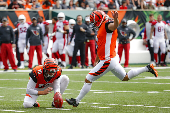 Cincinnati Bengals kicker Randy Bullock (4) boots a field goal alongside punter Kevin Huber (10) in the first half of an NFL football game against the Arizona Cardinals, Sunday, Oct. 6, 2019, in Cincinnati. (AP Photo/Frank Victores)