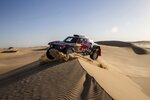 Driver Stephane Peterhansel, of France, and co-driver Paulo Fiuza, of Portugal, race their Mini during stage eight of the Dakar Rally in Wadi Al Dawasir, Saudi Arabia, Monday, Jan. 13, 2020. (AP Photo/Bernat Armangue)