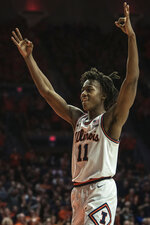 Illinois' Ayo Dosunmu (11) celebrates taking the lead over Indiana in the last minutes of the second half of an NCAA college basketball game Sunday, March 1, 2020, in Champaign, Ill. (AP Photo/Holly Hart)