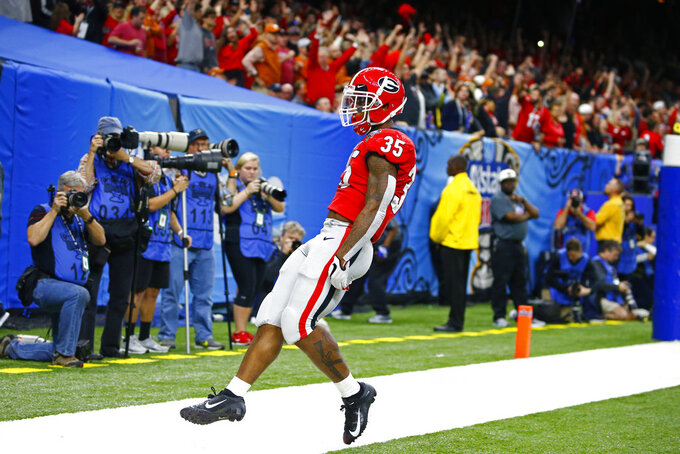 Georgia running back Brian Herrien scores a touchdown during the first half of the Sugar Bowl NCAA college football game against Texas in New Orleans, Tuesday, Jan. 1, 2019. (AP Photo/Butch Dill)