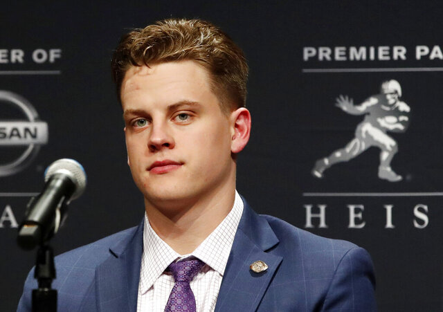 File-This Dec. 14, 2019, file photo shows NCAA college football player and Heisman Trophy finalist, LSU quarterback Joe Burrow listening to questions from the media during a news conference before the Heisman Trophy ceremony in New York. Burrow is a hero on LSU's Baton Rouge campus, but he hasn't seen much of it because he took graduate courses online. (AP Photo/Jason Szenes,File)