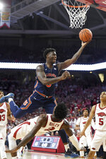 Auburn's Danjel Purifoy (3) is fouled by Arkansas defender Adrio Bailey (2) during the second half of an NCAA college basketball game Tuesday, Feb. 4, 2020, in Fayetteville, Ark. (AP Photo/Michael Woods)