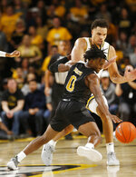 Alabama State's JJ Heath (0) tries to recover the ball as he is defended by Virginia Commonwealth's Marcus Santos-Silva (14) during an NCAA college basketball game in Richmond, Va., Monday, Nov. 25, 2019. (James H. Wallace/Richmond Times-Dispatch via AP)