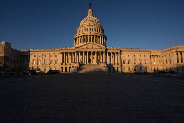 The Capitol is seen in Washington, early Wednesday, Dec. 18, 2019. President Donald Trump is on the cusp of being impeached by the House, with a historic debate set Wednesday on charges that he abused his power and obstructed Congress ahead of votes that will leave a defining mark on his tenure at the White House. (AP Photo/J. Scott Applewhite)