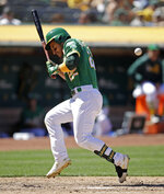 Oakland Athletics' Ramon Laureano is hit by a pitch thrown by Chicago White Sox's Kelvin Herrera during the sixth inning of a baseball game Saturday, July 13, 2019, in Oakland, Calif. A run scored on the play as the bases were loaded. (AP Photo/Ben Margot)