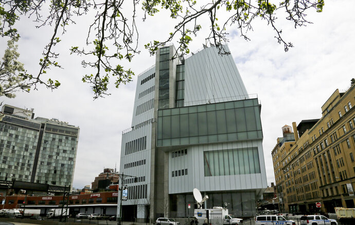 FILE- This April 30, 2015 photo shows an exterior view of the Whitney Museum of American Art in New York. Seven artists have asked the museum to remove their work from its biennial showcase of American art over a museum board member's ties to the sale of law-enforcement supplies including tear gas. (AP Photo/Bebeto Matthews, File)