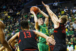 Oregon guard Payton Pritchard (3) shoots against Stanford forward Lukas Kisunas (32) during the first half of an NCAA college basketball game in Eugene, Ore., Saturday, March 7, 2020. (AP Photo/Thomas Boyd)