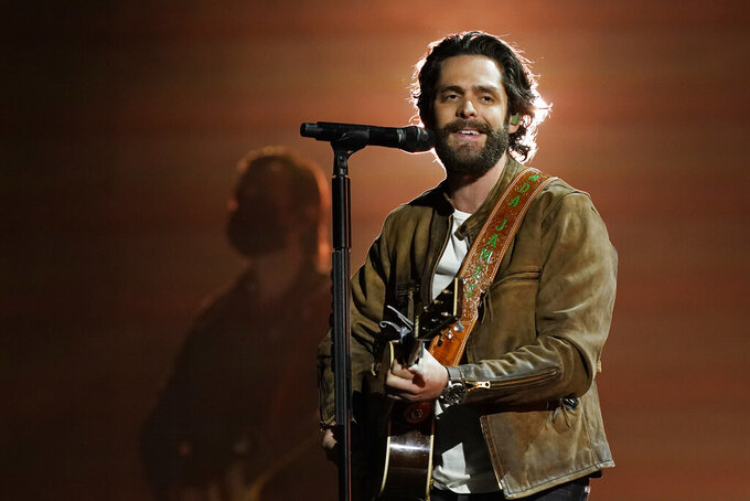 Thomas Rhett performs at the 56th annual Academy of Country Music Awards on Saturday, April 17, 2021, at the Grand Ole Opry in Nashville, Tenn. The awards show airs on April 18 with both live and prerecorded segments. (AP Photo/Mark Humphrey)