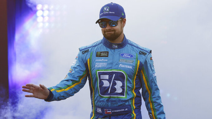 Ricky Stenhouse Jr. waves to fans during driver introductions prior to the start of the NASCAR Cup series auto race at Richmond Raceway in Richmond, Va., Saturday, April 13, 2019. (AP Photo/Steve Helber)