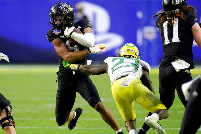 Iowa State wide receiver Xavier Hutchinson, left, is hit by Oregon safety Verone McKinley III (23) during the second half of the Fiesta Bowl NCAA college football game, Saturday, Jan. 2, 2021, in Glendale, Ariz. (AP Photo/Ross D. Franklin)
