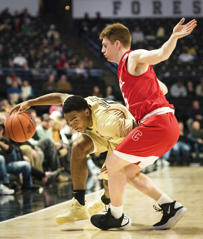 Wake Forest guard Brandon Childress (0) dribbles around Cornell guard Bryan Knapp (5) during the second half of an NCAA college basketball game Wednesday, Jan. 2, 2019, in Winston-Salem, N.C. (Allison Lee Isley/The Winston-Salem Journal via AP)