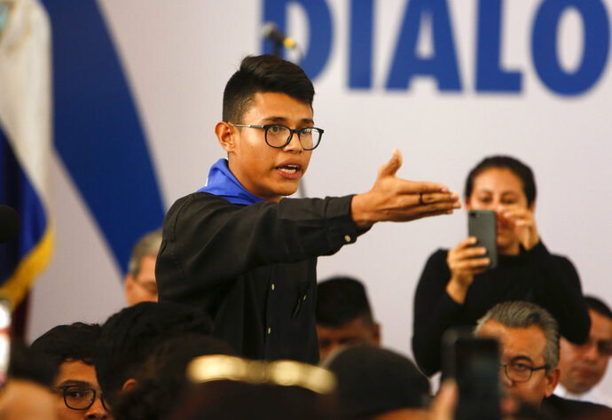 Student representative Lesther Aleman interrupts Nicaragua's President Daniel Ortega, shouting that he must halt the repression, during the opening of the national dialogue, on the outskirts of Managua, Nicaragua.