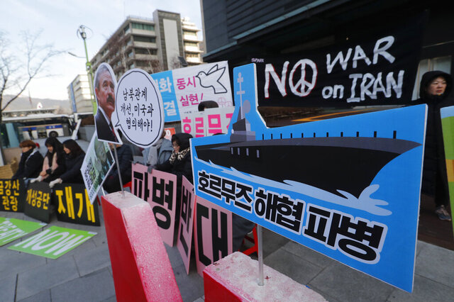 Anti-war activists stage a rally against the South Korean government's decision to send troops to Hormuz Strait, near the U.S. Embassy in Seoul, South Korea, Tuesday, Jan. 21, 2020. South Korean government on Tuesday said in a press release that the government had decided to send troops to Hormuz Strait to protect South Korean citizens and guarantee the freedom of navigation in the region. The sign reads