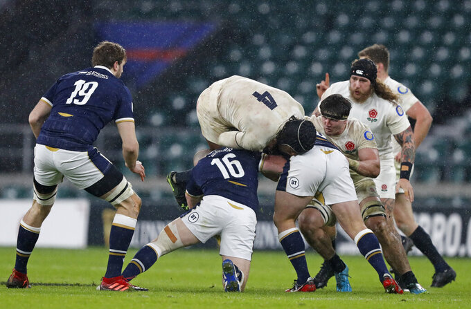 England's Maro Itoje, top center, goes over the top in a tackle during the Six Nations rugby union international between England and Scotland at Twickenham stadium in London, Saturday, Feb. 6, 2021. (AP Photo/Alastair Grant)