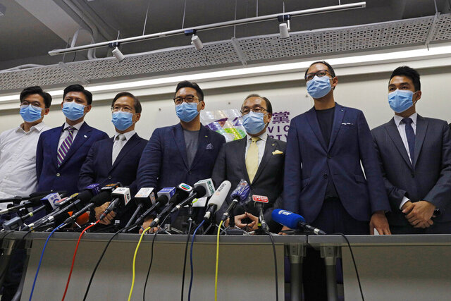 Pro-democracy Civic Party members, Cheng Tat-hung, right, Dennis Kwok, second right, Alvin Yeung, fourth right, and Kwok Ka-ki, fifth right, attend a news conference after disqualifying for a September legislative election in Hong Kong, Thursday, July 30, 2020. At least 12 Hong Kong pro-democracy nominees including Joshua Wong were disqualified for a September legislative election, with authorities saying Thursday they failed to uphold the city's mini-constitution and pledge allegiance to Hong Kong and Beijing. (AP Photo/Kin Cheung)