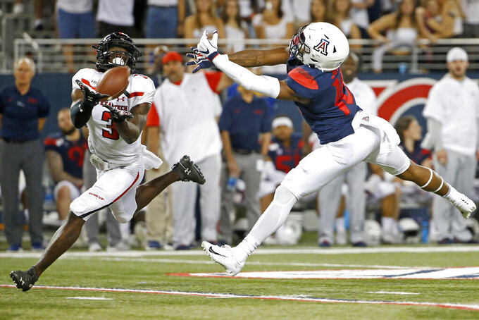 Texas Tech defensive back Douglas Coleman III (3) attempts to intercept a pass intended for Arizona wide receiver Jamarye Joiner (10) during the second half of an NCAA college football game, Saturday, Sept. 14, 2019, in Tucson, Ariz. (AP Photo/Ralph Freso)