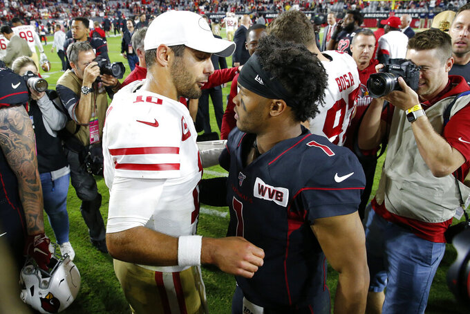San Francisco 49ers quarterback Jimmy Garoppolo (10) greets Arizona Cardinals quarterback Kyler Murray (1) after an NFL football game, Thursday, Oct. 31, 2019, in Glendale, Ariz. The 49ers won 28-25. (AP Photo/Rick Scuteri)