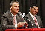 Ohio State NCAA college football head coach Urban Meyer, left, answers questions during a news conference announcing his retirement Tuesday, Dec. 4, 2018, in Columbus, Ohio. At right is assistant coach Ryan Day. (AP Photo/Jay LaPrete)