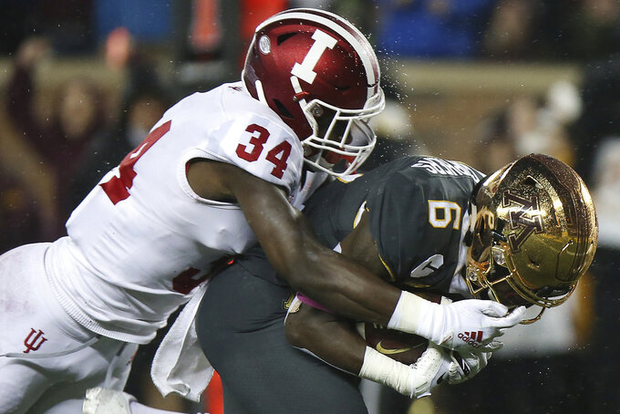 Indiana's Cam Jones tries to tackle Minnesota wide receiver Tyler Johnson during an NCAA college football game Friday, Oct. 26, 2018, in Minneapolis. (AP Photo/Stacy Bengs)