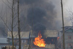 Flames and smoke billows from residential building where militants are suspected to have taken refuge during a gun battle in Pulwama, south of Srinagar, Indian controlled Kashmir, Monday, Feb. 18, 2019. Tensions continued to rise in the aftermath of a suicide attack in disputed Kashmir, with seven people killed Monday in a gunbattle that broke out as Indian soldiers scoured the area for militants. (AP Photo/ Dar Yasin)