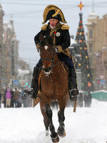 FILE - In this Monday, Jan. 7, 2013 file photo, Oleg Sokolov, a history professor at St. Petersburg State University, wears a 1812-era French army general's uniform during a reenactment of the French Invasion of Russia in 1812, during celebrations to mark the Russian Orthodox Christmas in St.Petersburg, Russia. Police in the Russian city of St. Petersburg are planning to interrogate a prominent professor who has been detained on suspicion of killing a female student after being pulled from a frigid river on Saturday, Nov, 9, 2019 with a backpack containing severed arms. (AP Photo/Dmitri Lovetsky, File)