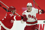 Detroit Red Wings defenseman Patrik Nemeth (22) checks Carolina Hurricanes center Martin Necas (88) in the first period of an NHL hockey game Thursday, Jan. 14, 2021, in Detroit. (AP Photo/Paul Sancya)
