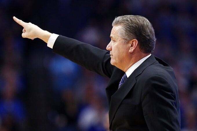 Kentucky coach John Calipari directs his team during the second half of an NCAA college basketball game against Vanderbilt in Lexington, Ky., Wednesday, Jan 29, 2020. (AP Photo/James Crisp)