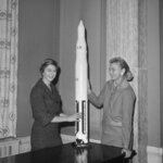 FILE - In this March 13, 1962 file photo, Jane Hart, left, wife of Sen. Philip Hart, D-Mich., and Jerrie Cobb of Oklahoma City pose with a model of a Saturn rocket at Capitol Hill in Washington. Two days later, they met with Vice President Lyndon B. Johnson in an effort to have the U.S. launch a program for female astronauts. Both women had successfully passed the physical tests given to male astronauts. Cobb, NASA's first female astronaut candidate, died in Florida at the age of 88 on March 18, 2019.(AP Photo/Henry Griffin)