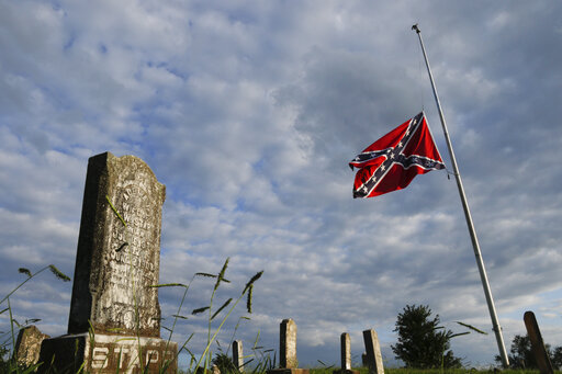 FILE- A confederate flag flies at half staff at Nathan Anderson Cemetery on Tuesday, Aug. 21, 2018, in Ringgold, Ga. A federal appeals court ruled Tuesday, Sept. 28, 2021, that the Georgia city of Alpharetta, an Atlanta suburb, did not violate the constitutional rights of a Sons of Confederate Veterans group when it banned the Confederate battle flag from its annual parade honoring veterans of American wars.  (Doug Strickland/Chattanooga Times Free Press via AP, File)
