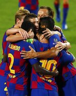 Barcelona's Lionel Messi celebrates with teammates after scoring his side's second goal during the Champions League round of 16, second leg soccer match between Barcelona and Napoli at the Camp Nou Stadium in Barcelona, Spain, Saturday, Aug. 8, 2020. (AP Photo/Joan Monfort)