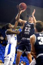 San Jose State guard Omari Moore (10) blocks a shot by Utah State guard Brock Miller (22) during the first half of an NCAA college basketball game Wednesday, Dec. 4, 2019, in San Jose, Calif. (AP Photo/Tony Avelar)