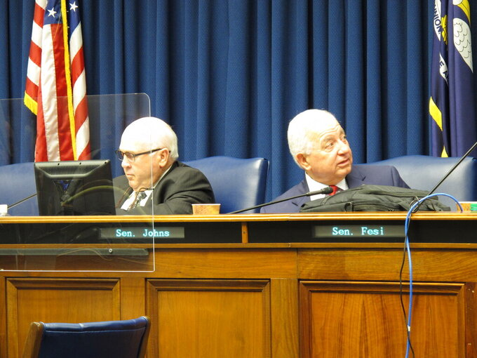 Senate Finance Chairman Bodi White, R-Central, left, and Sen. Ronnie Johns, R-Lake Charles, ready for a discussion of the Senate's budget proposal in a meeting of the Senate Finance Committee on Monday, May 24, 2021, in Baton Rouge, La. (AP Photo/Melinda Deslatte)