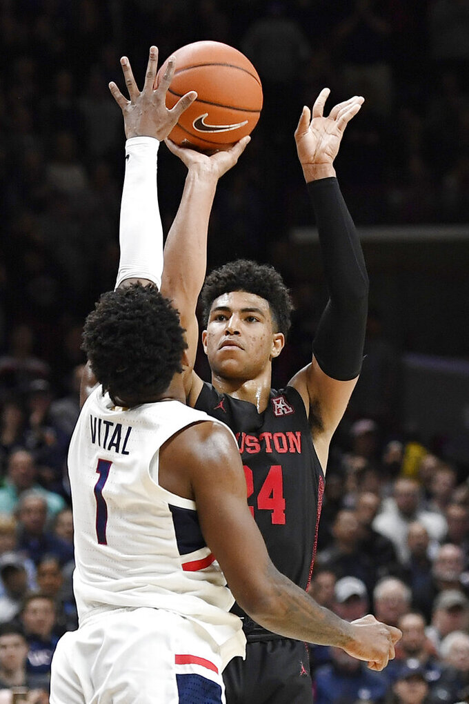 Houston's Quentin Grimes (24) shoots against Connecticut's Christian Vital (1) in the second half of an NCAA college basketball game, Thursday, March 5, 2020, in Storrs, Conn. (AP Photo/Jessica Hill)