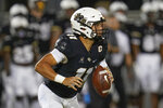 Central Florida quarterback Dillon Gabriel scrambles as he looks for a receiver during the first half of the team's NCAA college football game against Boise State, Thursday, Sept. 2, 2021, in Orlando, Fla. (AP Photo/John Raoux)