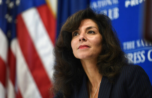 FILE - In this Sept. 21, 2018, file photo, A. Ashley Tabaddor, a federal immigration judge in Los Angeles who serves as the President of the National Association of Immigration Judges, listens as she is introduced to speak at the National Press Club​ in Washington, on the pressures on judges and the federal immigration court system. Immigration judges say they are being muzzled by the Trump administration and the union that represents them is suing the U.S. Department of Justice. The lawsuit filed Wednesday, July 1, 2020, is the latest confrontation between the judges and the Justice Department, which oversees U.S. immigration courts. (AP Photo/Susan Walsh, File)