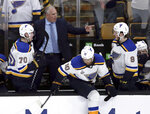 St. Louis Blues head coach Craig Berube, rear, gives his team instructions from behind the bench during the second period in Game 7 of the NHL hockey Stanley Cup Final against the Boston Bruins, Wednesday, June 12, 2019, in Boston. (AP Photo/Charles Krupa)