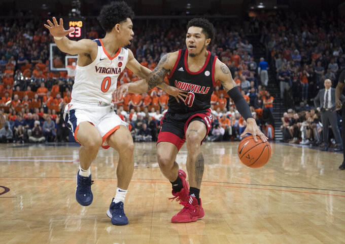 Louisville guard Lamar Kimble (0) drives against Virginia defender Kihei Clark (0) during the first half of an NCAA college basketball game in Charlottesville, Va., Saturday, March 7, 2020. (AP Photo/Lee Luther Jr.)