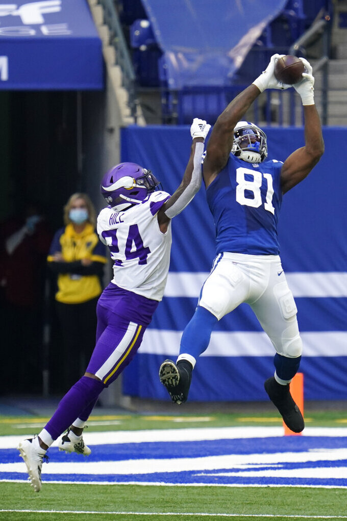Indianapolis Colts tight end Mo Alie-Cox (81) makes a catch against Minnesota Vikings' Holton Hill (24) during the second half of an NFL football game, Sunday, Sept. 20, 2020, in Indianapolis. (AP Photo/Michael Conroy)