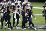 New Orleans Saints running back Alvin Kamara (41) and wide receiver Michael Thomas (13) celebrate in the first half of an NFL football game against the Tampa Bay Buccaneers in New Orleans, Sunday, Sept. 13, 2020. (AP Photo/Butch Dill)
