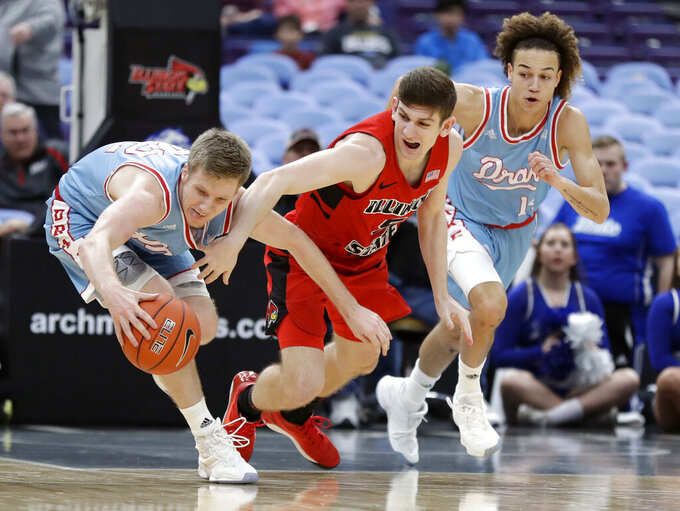 Drake's Brady Ellingson, left, and Illinois State's Matt Hein reach for the ball as Drake's Noah Thomas, right, watches during the first half of an NCAA college basketball game in the quarterfinal round of the Missouri Valley Conference tournament, Friday, March 8, 2019, in St. Louis. (AP Photo/Jeff Roberson)