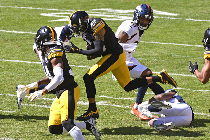Pittsburgh Steelers cornerback Joe Haden (23) runs after intercepting a pass by Denver Broncos quarterback Jeff Driskel (9) during the first half of an NFL football game in Pittsburgh, Sunday, Sept. 20, 2020. (AP Photo/Don Wright)